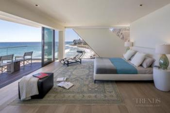 1950s beachside getaway is transformed into a sculptural new home