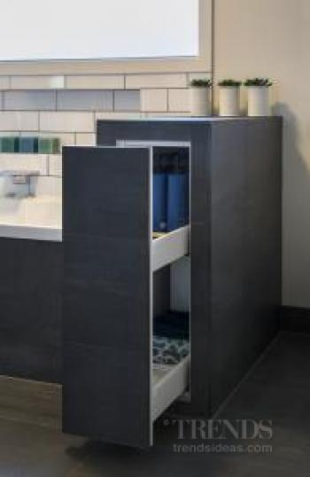 Off set white subway tiles are a feature of this bathroom for Bathroom storage ideas new zealand