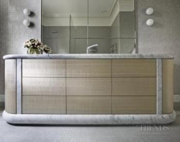 Glass mosaic surfaces give a refined look in these two renovated bathrooms