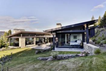 Home designed with two pavilions makes the most of lake and mountain views
