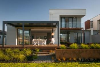 Crisp contemporary home benefits from  multi-clad look