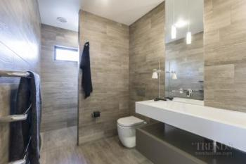 Ensuite with timber plank tiles achieves organic feel