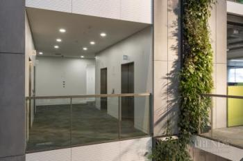 Off-white wall surfaces bring lightness to Fonterra lift lobbies