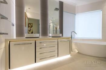 Mirror wall adds sense of space to renovated bathroom
