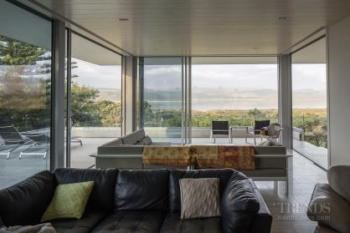 Major renovation reshuffles rear of home and opens up the front of the house to views