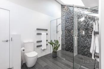 Mosaic feature walls add sparkle to modern bathroom design