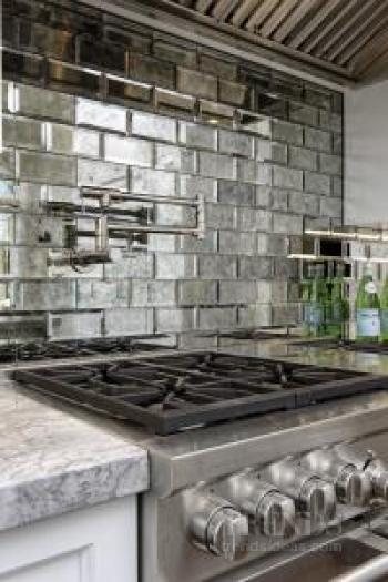 Antiqued Mirror Tiles And Traditionally Built Cabinetry