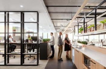 Its timber blind facade help make this Sydney office warm and approachable
