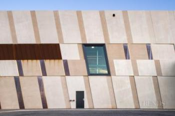 Drill core library achieves bold look with weathered steel and glass facade