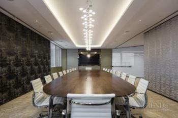 Investment company offices have the look of a traditional club or a five star hotel