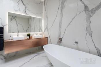 Series of bathrooms with feature copper and marble look surfaces
