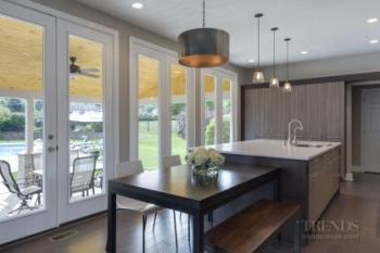 Remodeled kitchen now occupies a light-filled, breezy space