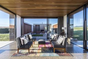 Multi-wing house reveals views slowly and features sheltered outdoor living spaces