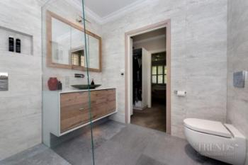 Designer tiles and a semi-freestanding tub are features of this ensuite
