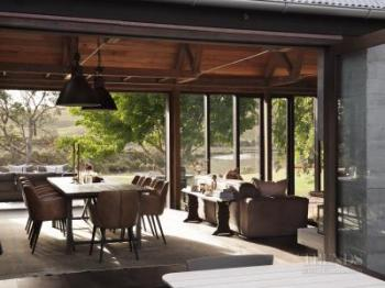 Different wood species and treatments feature in this award-winning home
