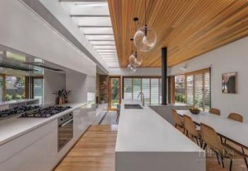 Modern family kitchen in house extension offers sightlines to indoor and outdoor areas