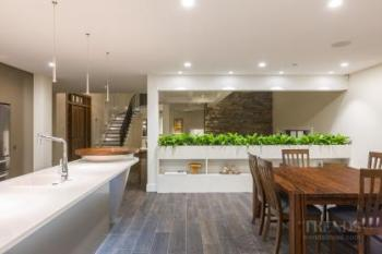 Dramatic kitchen island takes inspiration from the home's roof design