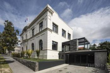 Two heritage buildings are combined and repurposed as a luxury apartment complex