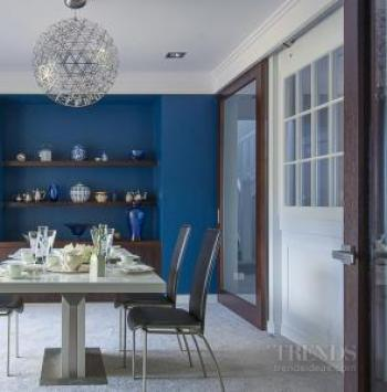 Strong colour helps anchor the interior design in this Arts & Crafts home