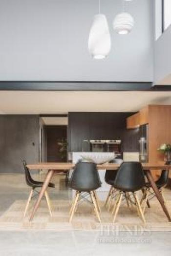 This kitchen fits into the wider open plan interior without dominating it