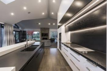 Contemporary kitchen echoes architecture of this new home