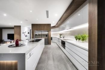 Entertainer kitchen's glamorous looks are achieved with hard-wearing surfaces
