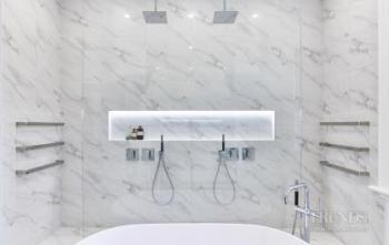 Back Design With Marblelook Tiles Creates Luxury Aesthetic For - An in depth look at 8 luxury bathrooms