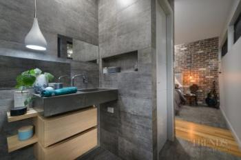 Bathroom and ensuite share wall and floor finishes, vanity designs and a contemporary aesthetic