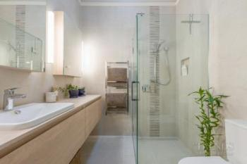 New bathroom spaces also respect traditional villa character of the home