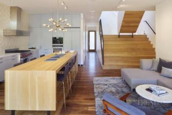 Kitchen island and formal dining table become one feature furniture piece in this new kitchen