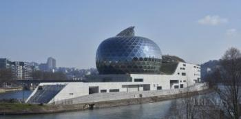 Sculptural music venue on The Seine includes giant kinetic sail of solar panels
