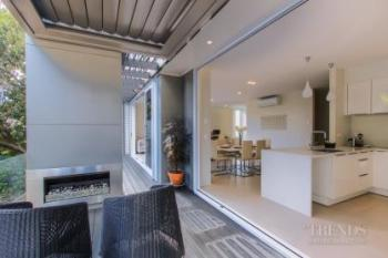 Private inner-city apartments maximise interior space and garden and harbour views