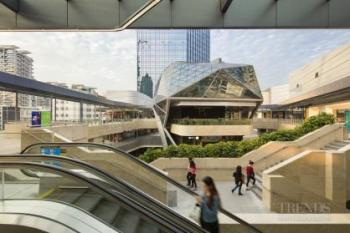 Retail pavilions, office tower and transportation hub integrate development into urban plan