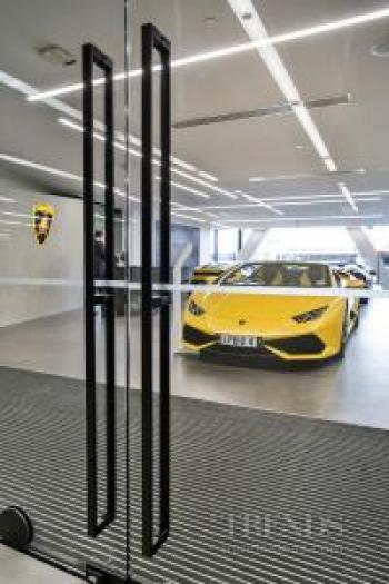 Striking door hardware complements showrooms in high-end car dealership