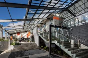Reinvented business hub animates busy inner-city street