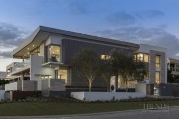 Shaped by coastal views and the weather, this large new home comes with several architectural flourishes
