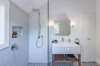 Children's bathroom and master ensuite in renovated villa share key design features