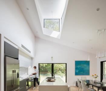 Kitchen renovation opens up surrounding spaces for better flow and functionality