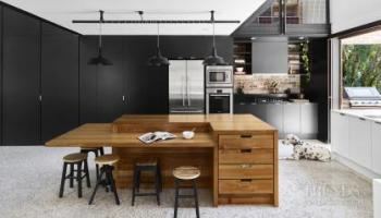 Part of a barn-style addition built with recycled materials, this kitchen continues the home's green design ethos