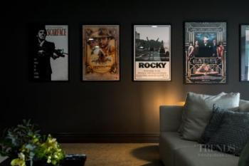 Dark wall tones give this media room a cosy, intimate feel