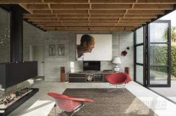 Award-winning home features exposed raw materials and a novel approach to layout