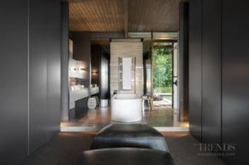Renovation totally opens up new bathroom to the dressing room and bedroom, with views beyond