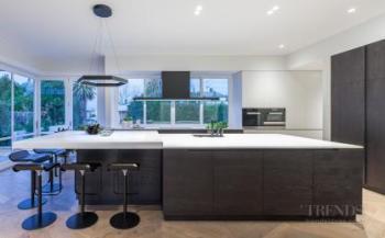 Contemporary upmarket kitchen suits renovated villa setting