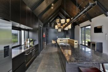 Semi-industrial family kitchen puts focus on raw natural materials