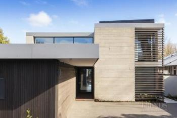 Private front facade gives way to openness and light at the rear of this new family home