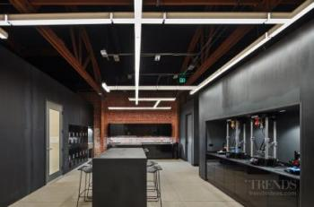 Historic brick building gets a deliberately stark, industrial yet elegant interior refit