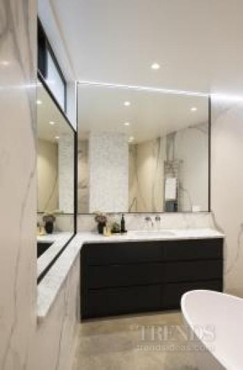 Spa-like master bathroom combines modern function with a classic feel