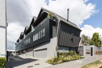 Terraced townhouses with a distinctive saw-tooth roof maximise use of a narrow inner city site