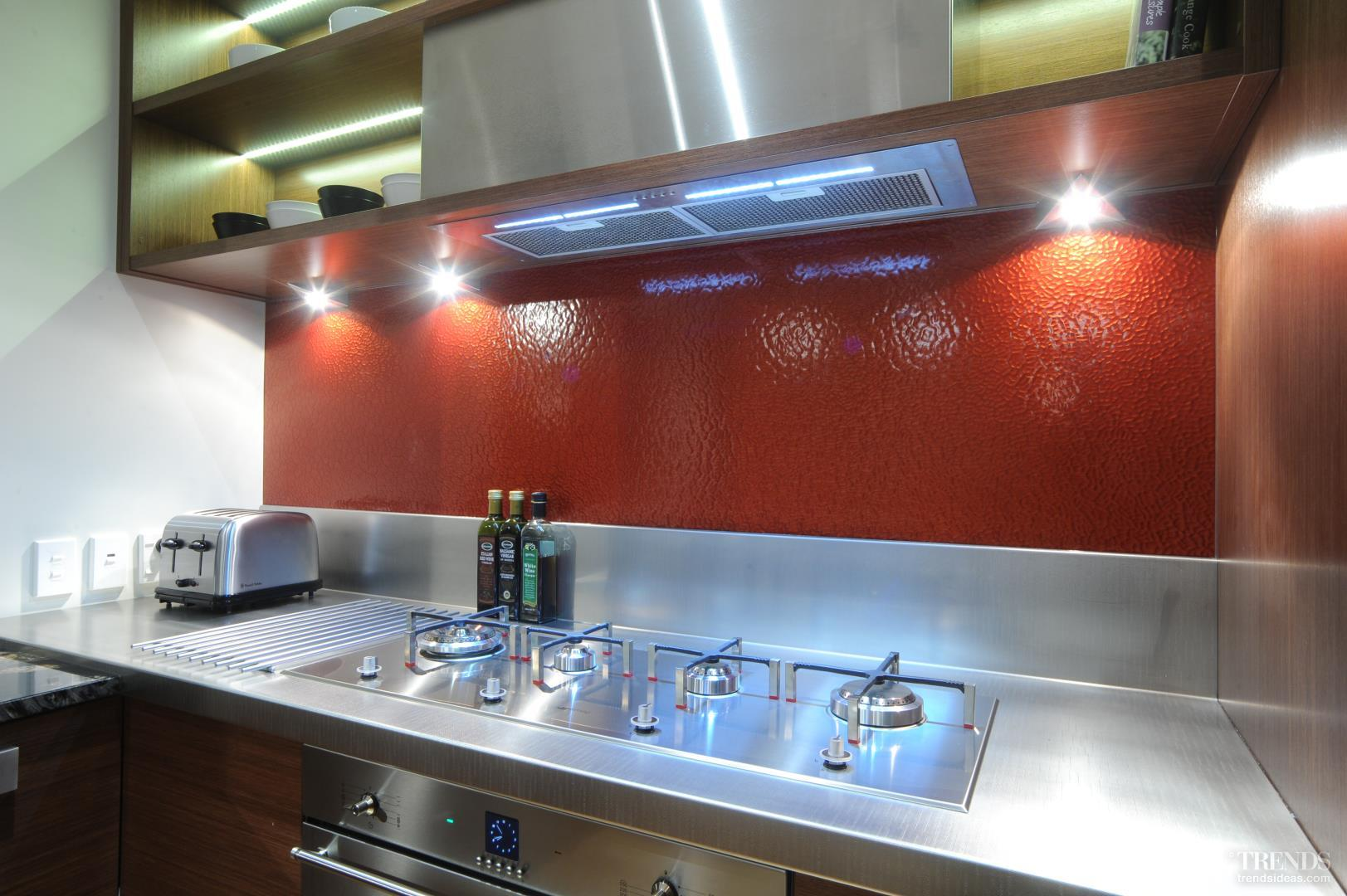 colourful new kitchen by suyin with glass splashback and