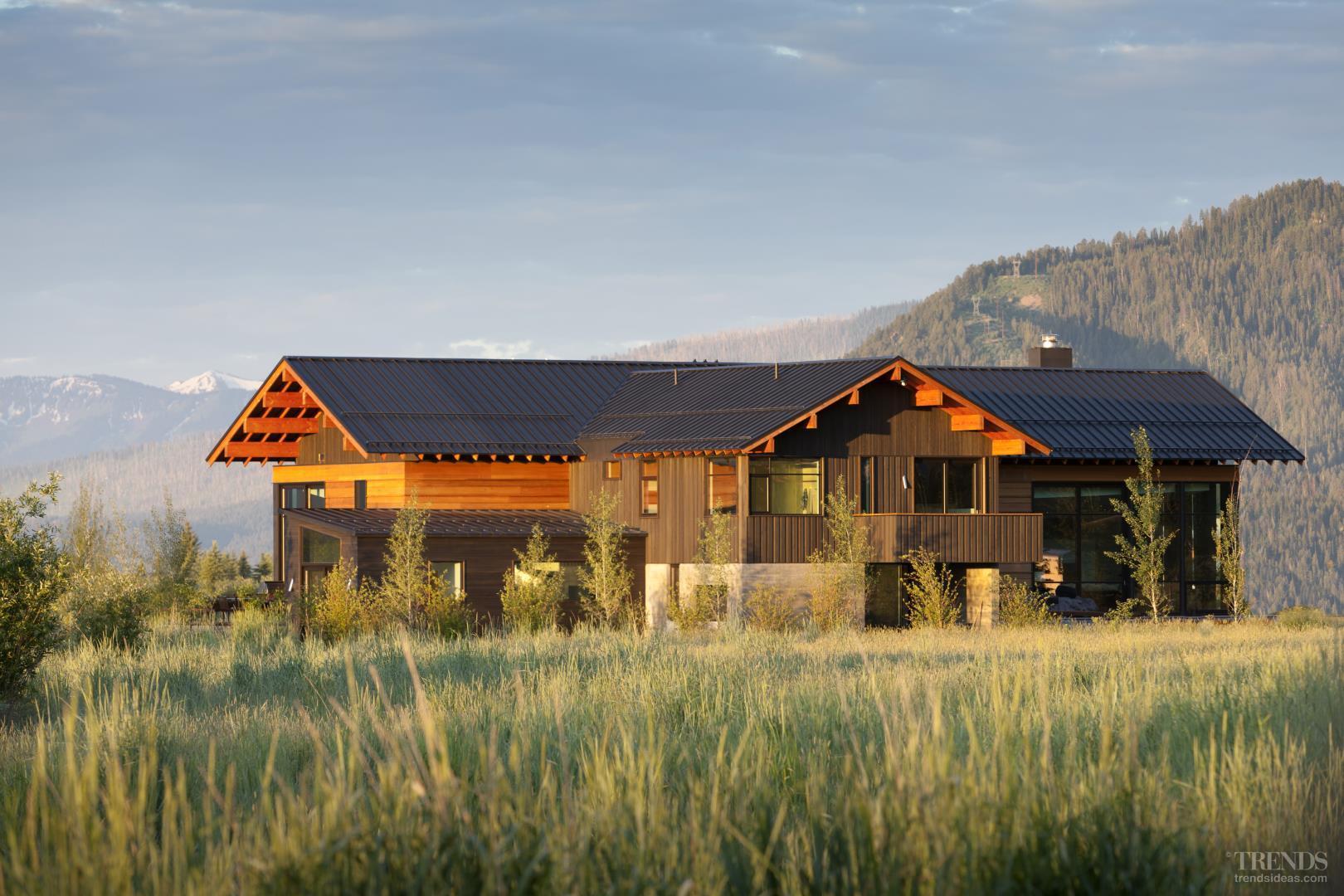 Mountain home with modern interior cedar siding zinc
